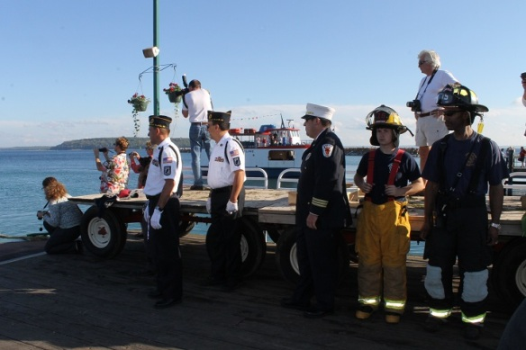 A Color Guard and a large crowd awaited the statue at the dock . . .