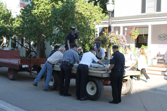 The Honor Guard gently removed the statue from the flat-bed . . .