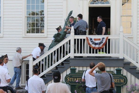 After the program and time for photo opportunities, the statue was carried into the Stuart House . . .