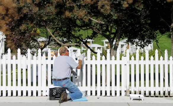 The picket fence at St. Anne's Church is getting a new coat of white paint.