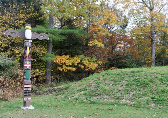 This totem pole sits on one side of the Spirit Garden burial mound . . .