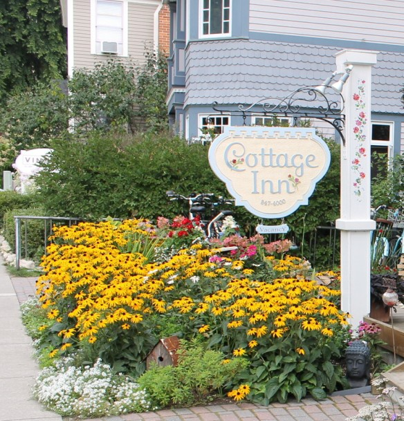 Even though summer is officially over on the calendar, Mackinac's flowers are still blooming their hearts out - like here at The Cottage Inn on Market Street.