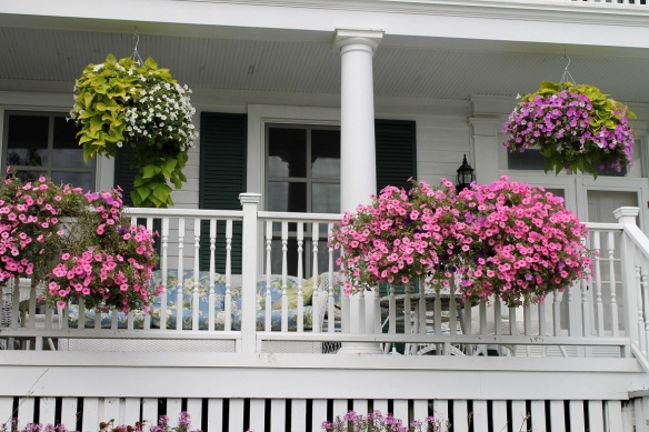 . . . seem to match these pink and green baskets on the front of this downtown cottage.