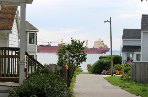A freighter passing . . . as seen between downtown condos.