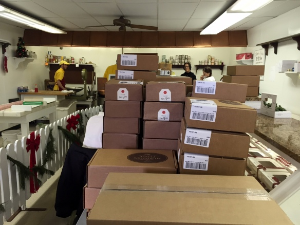 Assembled boxes are brought to the fudge shop, where they are packed with the customer's order . . .