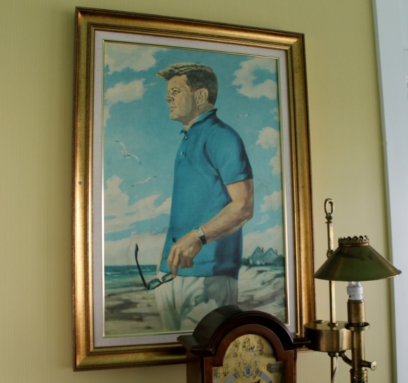 The walls are covered with presidential portraits, like this one of John F. Kennedy.
