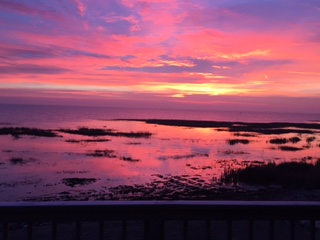 Mary M. lives on Saginaw Bay in Linwood MI. This is her view of the sun rising off her second floor deck. Wow!