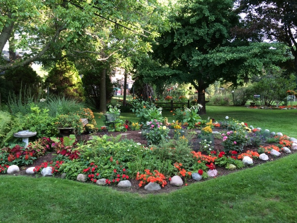 Pam's backyard in Livonia MI is home to this gorgeous flower garden. She shared that it used to be her husband's fish pond.