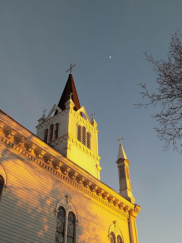 A TomChambers photograph of the setting sun reflecting off St. Anne's late on Valentine's Day.