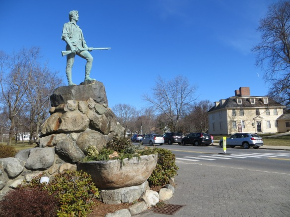 This is Arlington MA, home for Mary C. Arlington stands on the Arlington/Lexington line, and the statue is of Lexington Minuteman John Parker. That Buckman Tavern in the background, where minutemen assembled before the Battle on Lexington Green in 1775, starting the American Revolution.
