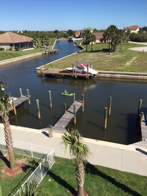 """Nothing that even resembles snow here in Sunset Inlet. A different view of our neighborhood from Cat Brooks - a neighbor """"across the way"""". That's her husband Eddie in the kayak."""