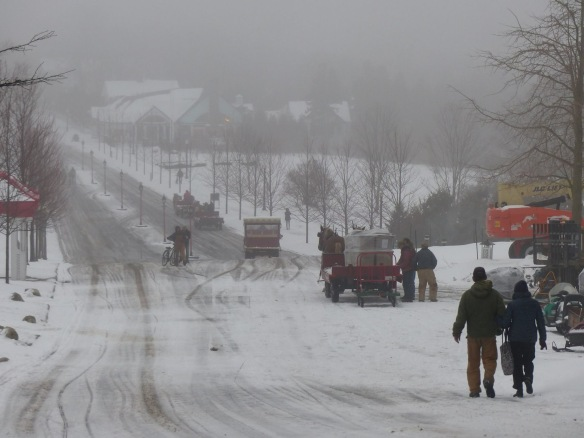 The same day, and through the snow workers make their way up the hill past Grand Hotel. (Photo: Clark Bloswick)