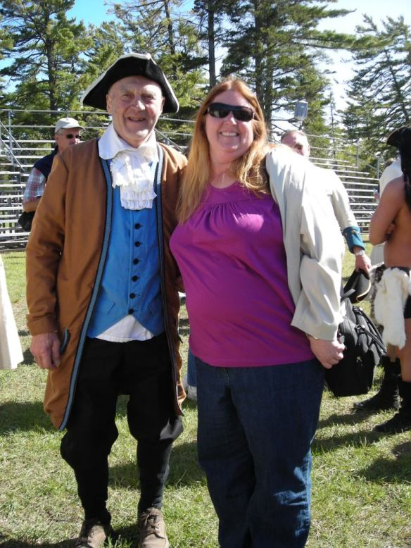 This smiling face belongs to Deborah Crawford from Midland Ontario, Canada. Deborah has been reading for 6-7 years after finding the blog link on Google. The photo is from a Memorial Day weekend at Colonial Fort Michilimackinac in Mackinaw City, and the handsome gentleman in the photo is a re-enactor portraying Deborah's 6 X great-grandfather, Ezekiel Solomon!
