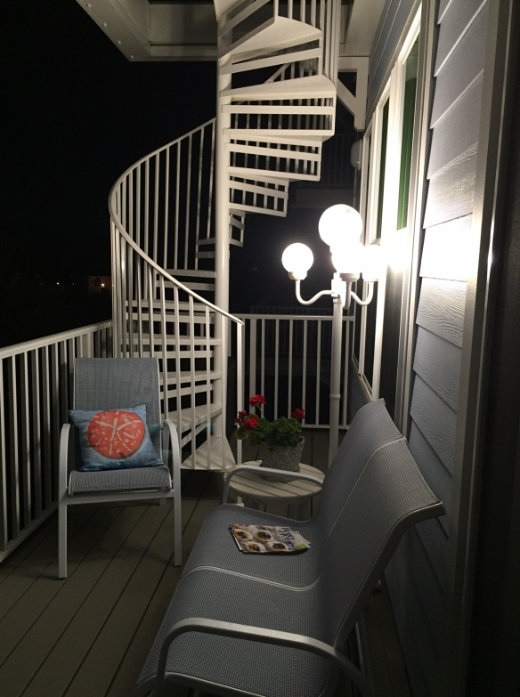 Ted and I went to out favorite outdoor furniture store last week to replace some chairs on the top deck that couldn't withstand all the wind and salt we get pounded with here. While there, I spotted this outdoor lamp and loved the way it looked. It's now on the second floor deck, and . . .