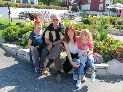 "Meet Jennifer Herko, her daughter Sarah, and her mom and dad. They hail from Warren OH. This photo is in front of The Island House in 2012, and that's when she became a reader. Jennifer says, ""If I could, I'd trade in my vehicle for a bike and snowmobile and go live on Mackinac!"" That's a dream a lot of folks have, Jennifer!"