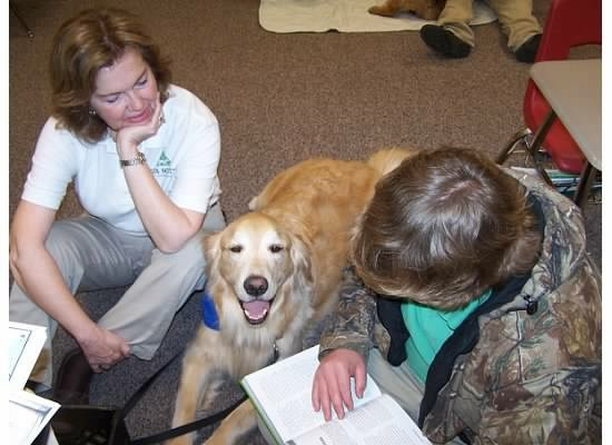 "One of his favorite things to do was to listen to children read to him. Middle school students gravitated toward the ""big yellow dog"", and he always patiently listened to every word."