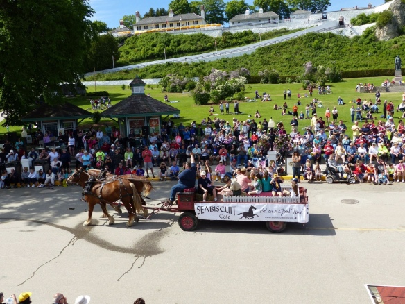 The Lilac Festival Parade! A great pic from Clark Bloswick of the Seabiscuit Café float, part of the crowd, and Fort Mackinac in the background.