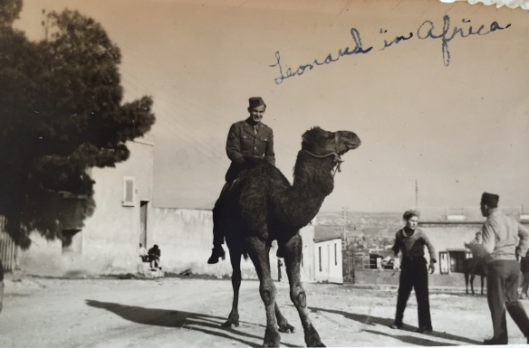 Serving in Africa during World War II. He loved this photo of himself on a camel.