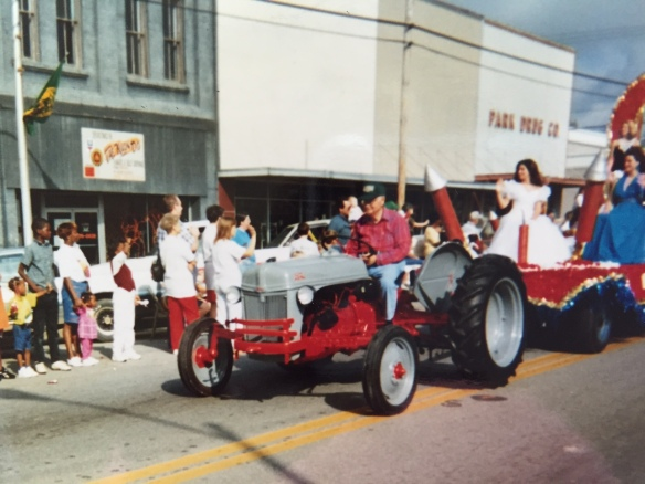 "He had an old tractor that he used to work his ""garden"" until the year he died. He'd use it to pull a float each year in the Sylvester Peanut Festival parade. The year after he died, my son Jason drove that same tractor in the parade in honor of his granddaddy."