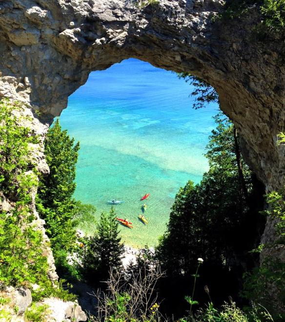 One more from Sandi. The crystal clear blue waters of Lake Huron, framed by Arch Rock. The brightly colored kayaks just pop against that water!