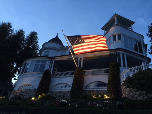 An illuminated American flag on the West Bluff.