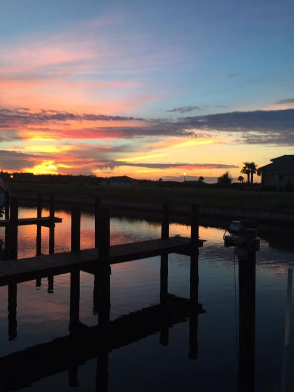 . . . and amazing sunsets. When they named our little neighborhood Sunset Inlet, they sure knew what they were doing, didn't they? (Photo: Neighbor Monika O'Connor)