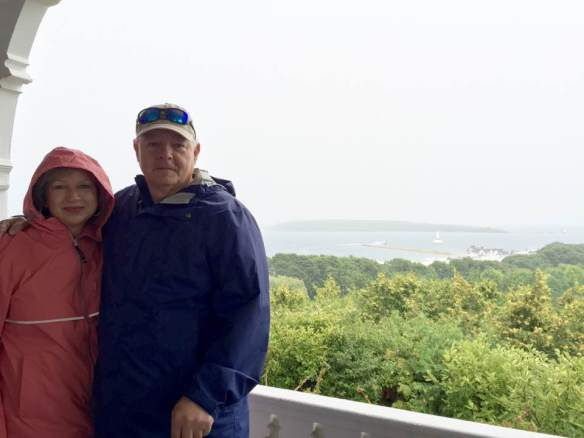 """Today it rained on Mackinac. But it did not keep anyone from continuing to enjoy this paradise. Glen and I went on the ""once a week"" tour of the Governor's Cottage this morning. Because of the rain and the very steep hill that it sits on we took a taxi which is a horse drawn carriage."""