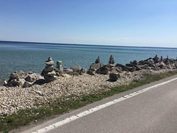 """Today the Hortons (who are in very good shape), the Harters (who can ride a tandem bike in total unison) and Glen and I (who are very out of shape) rode bikes on the 8.2 mile bike/horse road that completely circles the outer edge of Mackinac Island."""