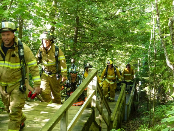 Firefighters walked the stairs to Fort Holmes (141 steps) repeatedly until they made their goal of 14 round trips . .