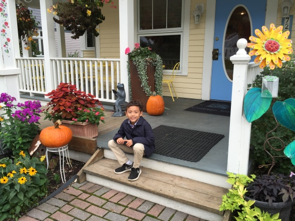 Alex among the pumpkins on the steps of The Cottage Inn on Market Street.