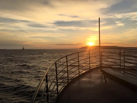 Sunrise from the water on November 17 by Stephanie Fortino on her way to the island.