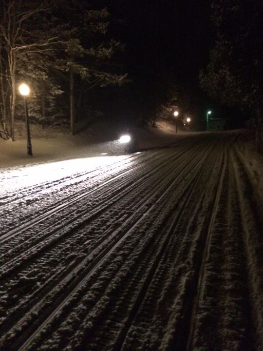 A lone snowmobile makes the run up Cadotte on a wintry night. (Photo: Pam Day)