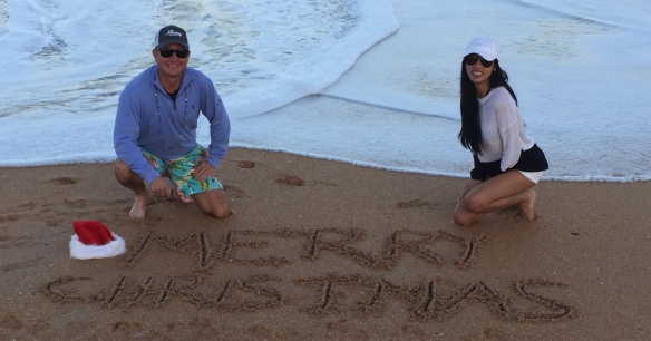 Jason and Jen wishing everyone Merry Christmas from the beach on Facebook . . .