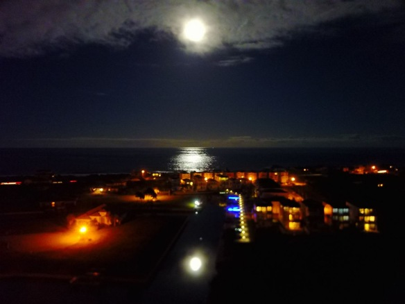 —A magical image of our neighborhood with the moon reflected in both the ocean and our inlet. (Photo: Neighbor Bob Hewit - from his drone)