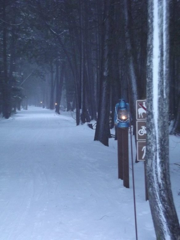 A groomed trail for the first Twilight Trek in January. Lanterns are hug to light the way.